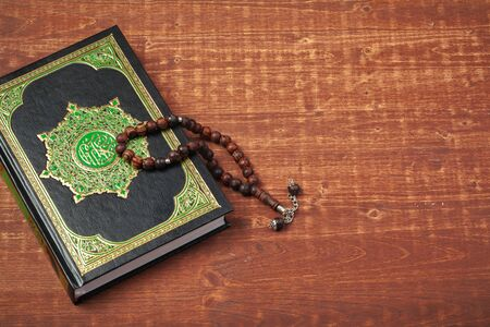 Three months. Islamic Holy Book Quran with rosary beads. Ramadan concept. Creative photo.