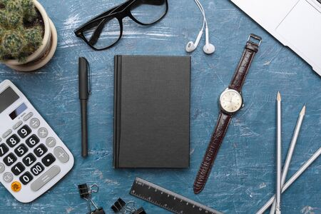 Creative flat lay photo of workspace desk blank black notebook with copy space background, minimal style