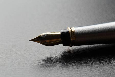 Fountain pen on black background