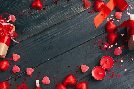 Gift box with red hearts on wooden table. creative photo.