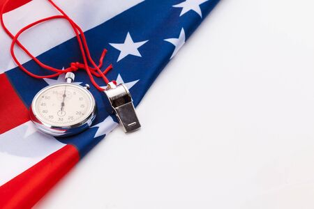 Metal Sport Whistle And Stopwatch On American Flag. creative photo.