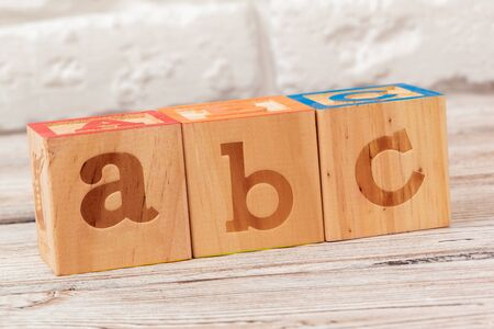 Wooden toy Blocks with the text: abc. creative photo.