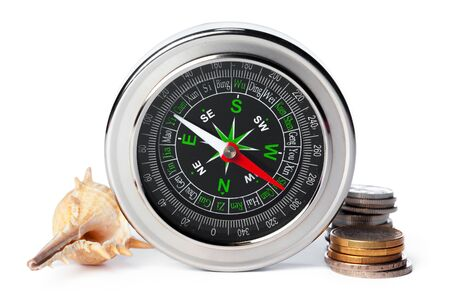sea shells and old compass with sand isolated on white background