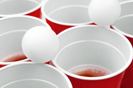 Cups for game Beer Pong on the table. creative photo. Foto de archivo