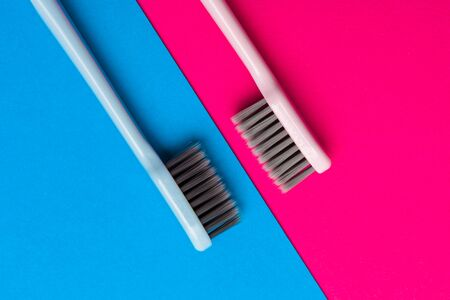 Flat lay composition with manual toothbrushes on color background, close up. creative photo.