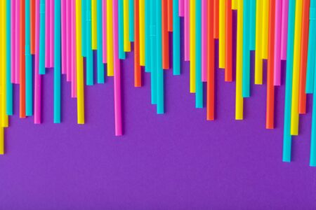 Colorful straws for beverage soft drink on colored background. creative photo. Imagens