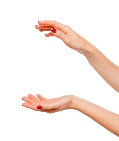 Close-up of beautiful woman's hands, palms up. Isolated on white background. creative photo.