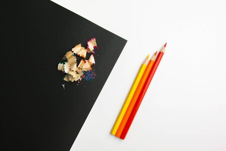 The difference between black and white color pencils. creative photo.