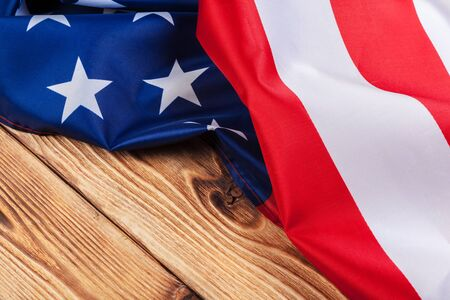 USA flag on light wooden table background close up copy space Banco de Imagens