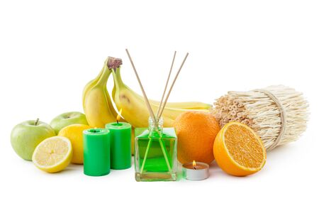 Still life of tropical fruits, essential oils and aroma diffuser. creative photo.