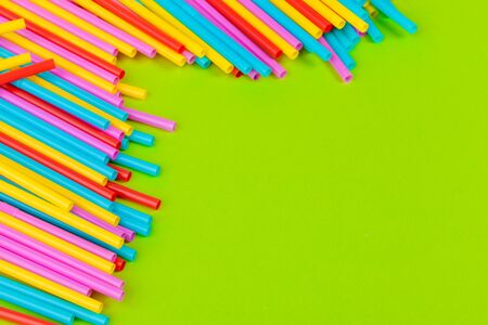 Colorful straws for beverage soft drink on colored background creative photo.