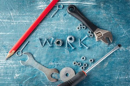 work is written by metal bolts, screws, svermami, wrenches creative photo.