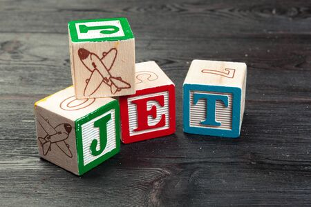 Jet printed on three wooden dice. Transportation concept. creative photo. Stock fotó