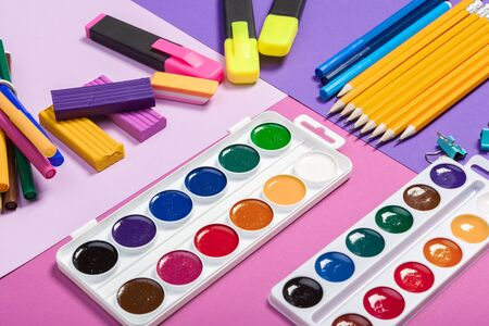 school supplies at abstract colorful background texture. creative photo.
