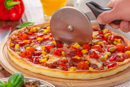 Delicious fresh pizza served on wooden table. creative photo.