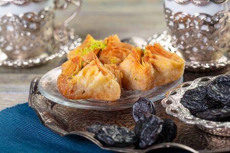 Oriental sweets, baklava, sherbet on a blue background. creative photo.