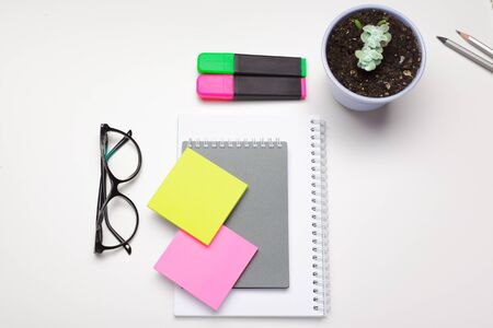 Sticky notes with markers, colored pens, paper clips laying on a table. creative photo. Stock Photo