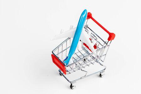 Mini Shopping Cart On The Table. Business , e-commerce concept creative photo.