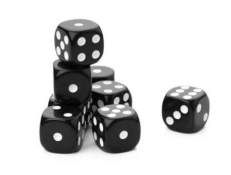 black dice on a white background creative photo.