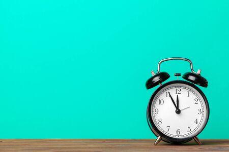 retro alarm clock on table. creative photo. Standard-Bild