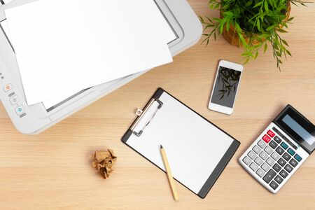 Working place of a business person. printer and other office supplies. creative photo.