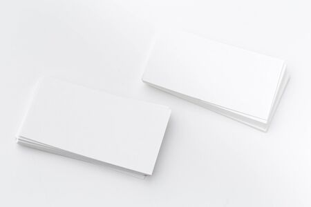 Stack Of Blank White Businesscards on White Background. creative photo. Banque d'images