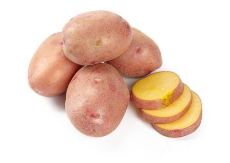 raw potato tuber with slices isolated on white creative photo. Reklamní fotografie