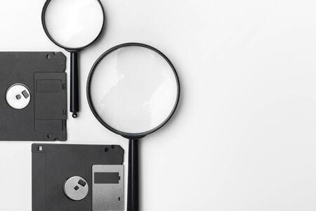 magnifying glass inspecting on floppy disk concept 版權商用圖片