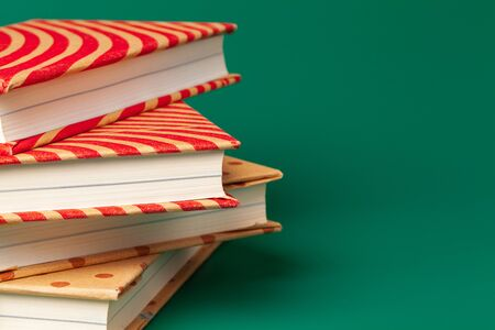 books isolated on green background. creative photo.