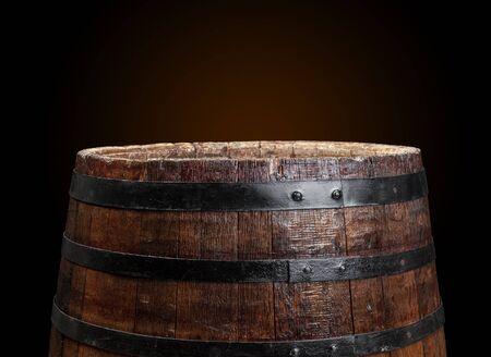 Old wooden barrel on a dark background. Close up. Archivio Fotografico