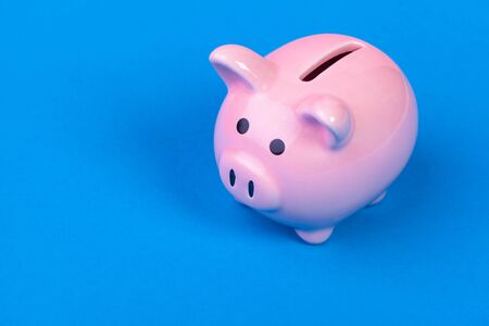 Pinik piggy bank on bright colored background. Close up.