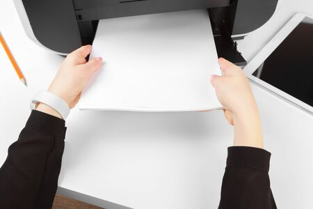 Woman using the printer to scanning and printing document. Close up. Banque d'images