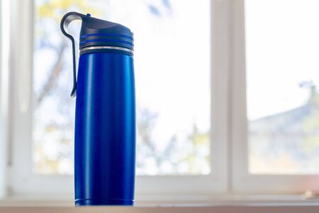 Close up of a thermos flask in a daylight