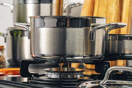 Clean saucepan on a gas stove in kitchen. Close up.