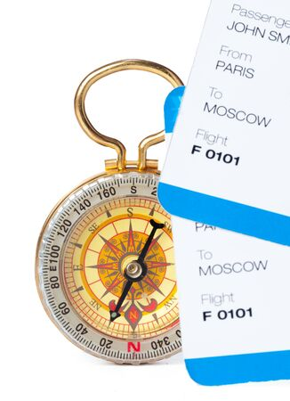 Time to Travel. Idea for tourism with ticket and compass isolated. Concept on the theme of flights. Close up.