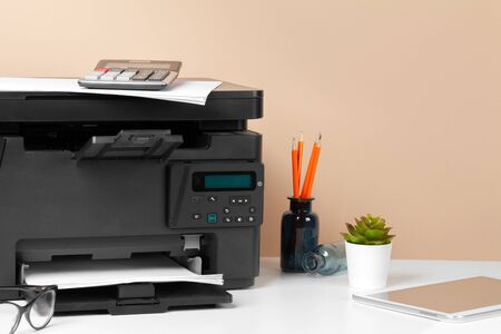 Printer, copier, scanner in office. Workplace. Close up. Standard-Bild