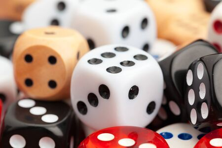 Dice on a wooden table. Concept for business risk. Close up.
