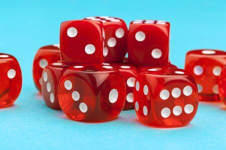 Gaming dices on blue background. Game concept. Stock Photo