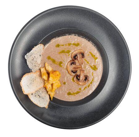 A bowl of delicious homemade cream of mushroom soup. Close up.