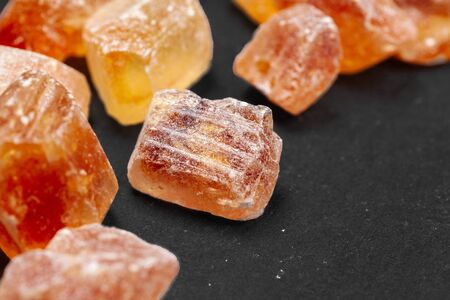 brown sugar rock organic crystalline on dark background