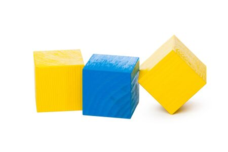 Wooden building blocks isolated on white background. Close up.
