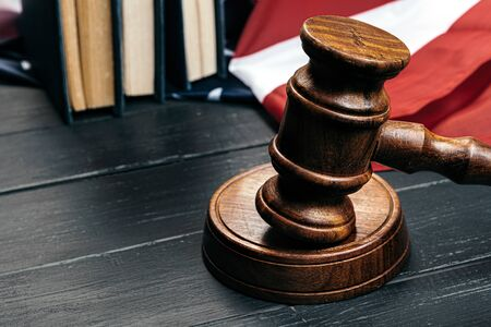 Judge gavel on the background of the flag united states of America. Close up.