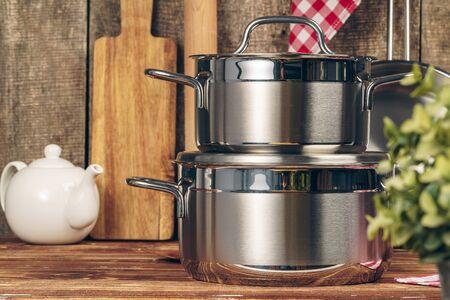 Set of stainless steel saucepans in a kitchen Stok Fotoğraf
