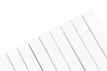 Group of white chalk pieces isolated on white background. Close up.