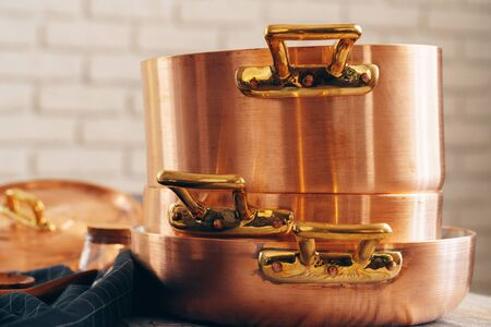 New copper cookware for professional kitchen close up