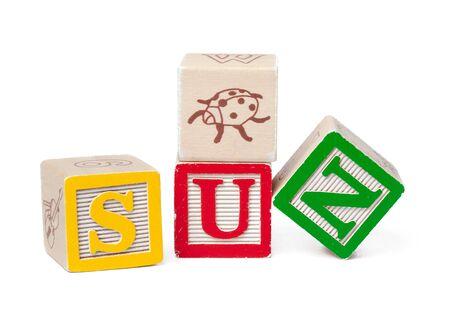Colorful alphabet blocks. Word sun isolated on white background