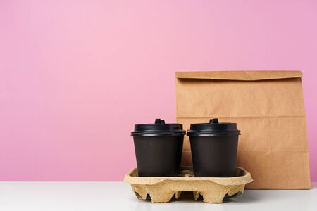 Paper bags with take away food and coffee cups containers. Lunch box