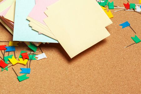 Sticky notes with copy space on cork board