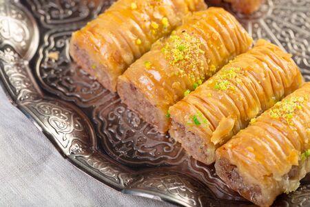 Turkish sweets baklava and metal oriental tray on wooden background 版權商用圖片