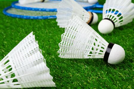 Badminton game rackets and shuttlecock on grass. Close up. Stock Photo